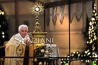 Pope Benedict XVI wafts incense as he leads the Corpus Domini mass in Rome's Basilica of St. John's in Lateran on June 23, 2011. .