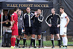 29 November 2015: Referee Hilario Chico Grajeda flips the coin for Indiana's Derek Creviston (left) and Wake Forest's Ian Harkes (right) before the game. The Wake Forest University Demon Deacons hosted the Indiana University Hoosiers at Spry Stadium in Winston-Salem, North Carolina in a 2015 NCAA Division I Men's Soccer Tournament Third Round match. Wake Forest won the game 1-0.