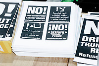 A group handed out flyers, posters, and stickers for RefuseFascism.org in Cambridge Common during a Tax Day protest near Harvard Square in Cambridge, Mass., on Sat., April 15, 2017. The demonstrators called for President Donald Trump to release his tax returns. Trump refused to release his tax returns during the 2016 presidential campaign, in contrast to all previous major party presidential candidates, and continues to refuse to release them. The protest was part of a larger movement nationwide called Tax March.
