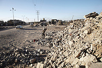 A man breaks apart rubble at a stone factory in Beit Hanoun, Gaza. With more cement entering Gaza through the tunnels from Egypt there is a growing demand for aggregates for making concrete.