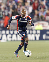 New England Revolution defender Jose Goncalves (23) brings the ball forward and looks to pass.In a Major League Soccer (MLS) match, the New England Revolution (blue/red) defeated Philadelphia Union (blue/white), 2-0, at Gillette Stadium on April 27, 2013.