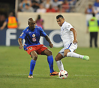 Mario Martinez (10) of Honduras goes against Yves Hadley (15) of Haiti.  Honduras defeated Haiti 2-0 in the first round of the CONCACAF Gold Cup, at Red Bull Arena, Monday July 8 , 2013.