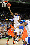 31 MAR 2012: Guard Darius Miller (1) from the University of Kentucky drives to the basket during the Semifinal Game of the 2012 NCAA Men's Division I Basketball Championship Final Four held at the Mercedes-Benz Superdome hosted by Tulane University in New Orleans, LA. Ryan McKeee/ NCAA Photos.