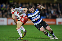 James Hook of Gloucester Rugby is tackled by David Wilson of Bath Rugby. Aviva Premiership match, between Bath Rugby and Gloucester Rugby on February 5, 2016 at the Recreation Ground in Bath, England. Photo by: Patrick Khachfe / Onside Images