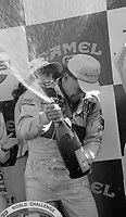 Price Cobb gets celebrates with champagne in victory lane after driving his Castrol Racing Jaguar XJR-10 to victory in the IMSA GTP/Lights race at the Florida State Fairgrounds in Tampa, FL, October 1, 1989.  (Photo by Brian Cleary/www.bcpix.com)