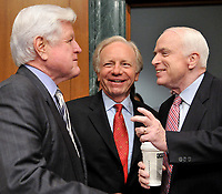 """Washington, DC - April 8, 2008 -- From left to right: United States Senators Edward M. """"Ted"""" Kennedy, (Democrat of Massachusetts); Joseph I. Lieberman (Independent Democrat of Connecticut), and John McCain (Republican of Arizona) share a conversation prior to hearing the testimony of General David Petraeus and Ambassador Ryan Crocker before the United States Senate Armed Services Committee on the situation and progress in Iraq in Washington, D.C. on Tuesday, April 8, 2008..Credit: Ron Sachs / CNP/MediaPunch"""