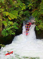 A kayaker watches as a raft from River Rats Rafting goes off the 7 meter (21 foot) Tutea Falls on the Kaituna River (the highest commercially rafted waterfall in the world), near Rotorua, on the North Island of New Zealand.