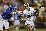 29 April 2016: Notre Dame's Drew Schantz (20) and Duke's John Prendergast (left). The University of Notre Dame Fighting Irish played the Duke University Blue Devils at Fifth Third Bank Stadium in Kennesaw, Georgia in a 2016 Atlantic Coast Conference Men's Lacrosse Tournament semifinal match. Duke won the game 10-9 in overtime.