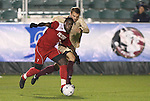 13 November 2009: NC State's Ronnie Bouemboue (7) and Boston College's Sacir Hot (behind). The North Carolina State University Wolfpack defeated the Boston College Eagles 1-0 at WakeMed Stadium in Cary, North Carolina in an Atlantic Coast Conference Men's Soccer Tournament Semifinal game.