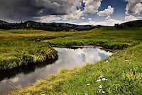 Storm clouds over San Antonio Creek in Valle San Antonio at the Valles Caldera National Preserve in the Jemez Mountains of north-central New Mexico.