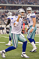 ARLINGTON,  TX - NOVEMBER 6:   Tony Romo #9 of the Dallas Cowboys celebrates after a touchdown against the Seattle Seahawks at Cowboys Stadium on November 6, 2011 in Arlington, Texas.  The Cowboys defeated the Seahawks 23 to 13.  (Photo by Wesley Hitt/Getty Images) *** Local Caption *** Tony Romo