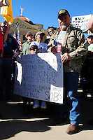 """Phoenix, Arizona. January 19, 2013 - A protester who attended Saturday's rally in Phoenix opposes the president's proposed changes to gun laws in America by holding a sign that parodies a government official's oath of office. As President Barack Obama proposed new gun regulations last week, gun owners demonstrated against it with national """"Guns Across America"""" rallies to defend the Second Amendment. Dozens showed up at the Arizona State Capitol, many of them carrying weapons. Photo by Eduardo Barraza © 2013"""