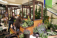 "A long-exposure image of students frantically working to finish Orange Coast College's Ornamental Horticulture Club's in-progress installation at the 2012 South Coast Plaza Spring Garden Show in Costa Mesa, CA.  The theme for this year's show is ""healing gardens"", and the OCC team is installing a ""garden for the blind,"" which will be complete with a braille world globe and braille labels.  This picture was taken Tuesday April 25, 2012 at ~11pm, as the team was working to meet their Thursday-morning deadline."