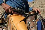 Cowboy and saddle on horse