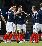 Kenny Miller celebrates with Jamie Mackie and Sean Maloney
