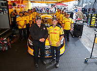 Aug 20, 2016; Brainerd, MN, USA; NHRA funny car team owner Connie Kalitta and driver Del Worsham poses for a photo with his crew to commemorate the 500th start of his career during qualifying for the Lucas Oil Nationals at Brainerd International Raceway. Mandatory Credit: Mark J. Rebilas-USA TODAY Sports