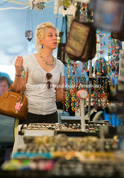 WATERBURY, CT--051015JS05- Cleo Galanos of Watertown, looks over some of the jewelry and accessories available for sale during the 43rd annual Greek Festival Sunday at the Holy Trinity Greek Church in Waterbury.<br /> Jim Shannon Republican-American