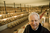 "Switzerland. Canton Ticino. Ligornetto. Luigi Zanini. Wine grower and producer. Owner of the firm ""Vinattieri Ticinesi"". Luigi Zanini stands in the cellar, named ""Tempio del Vino"". Fully underground, the cellar harbours 850 oak barrels. The special construction, an idea of Luigi Zanini, permits the wines tranferred ""in free fall"" from one barrel to the other.  © 2008 Didier Ruef .."