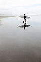 WA09804-00...WASHINGTON - Surfer at Westhaven State Park near Westport.