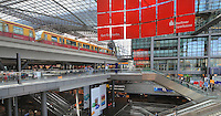 Inside the concourse of Berlin Hauptbahnhof, the main train station in Berlin, with shops, restaurants and escalators, and an U-Bahn train, Berlin, Germany. Picture by Manuel Cohen