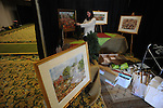 Artist Ann Seale of Jackson, Miss. sets up for the Oxford Holiday Market at the Oxford Conference Center in Oxford, Miss. on Thursday, November 15, 2012. The market is open for a preview party on Thursday; from 10 a.m.-7 p.m. on Friday; and 10 a.m.-4 p.m. on Saturday.