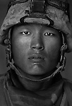 Lcpl. Don Choi, 20, Cypress, California, 1st Platoon, Kilo Company, 3rd Battalion 1st Marines, 1st Marine Division, United States Marine Corps at the company's firm base in Haditha, Iraq on Thursday, Oct. 12 2005.