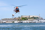 A United States Coast Guard HH-65C Dolphin hovers above the San Francisco Bay west of Alcatraz Island.The helicopter and crew, based at U.S. Coast Guard Air Station San Francisco, was on a practice mission with the Coast Guard Auxilary to maintain search and rescue proficiency. Photographed 04/08