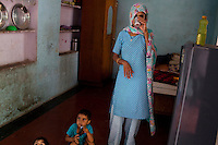 Nafeesa, 27, takes a break from rolling bidis (indian cigarettes) in her house in a slum in Tonk, Rajasthan, India, on 19th June 2012. Nafeesa's health deteriorated from bad birth spacing and over-working. While her husband works far from home, she rolls bidis to make an income and support the family. She single-handedly runs the household and this has taken a toll on her health and financial insufficiencies has affected her children's health. Photo by Suzanne Lee for Save The Children UK