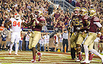 Florida State running back Dalvin Cook reacts to scoring a touchdown against Clemson in the first half of an NCAA college football game in Tallahassee, Fla., Saturday, Oct. 29, 2016. (AP Photo/Mark Wallheiser)
