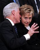 Former United States President Bill Clinton whispers something into the ear of former first lady Senator Hillary Rodham Clinton (Democrat of New York) during the State Funeral for former United States President Gerald R. Ford at the Washington National Cathedral, in Washington, D.C. on Tuesday, January 2, 2007..Credit: Ron Sachs / CNP.[NOTE: No New York Metro or other Newspapers within a 75 mile radius of New York City].