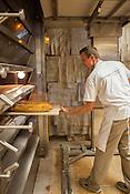 Cary, North Carolina - Saturday September 19, 2015 - Stephen Polzin removes fresh bread from the oven at La Farm Bakery Saturday September 19, 2015 in Cary, North Carolina.