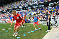 Carl Robinson (33) and Sinisa Ubiparipovic (8) of the New York Red Bulls warm up prior to a friendly between Santos FC and the New York Red Bulls at Red Bull Arena in Harrison, NJ, on March 20, 2010. The Red Bulls defeated Santos FC 3-1.