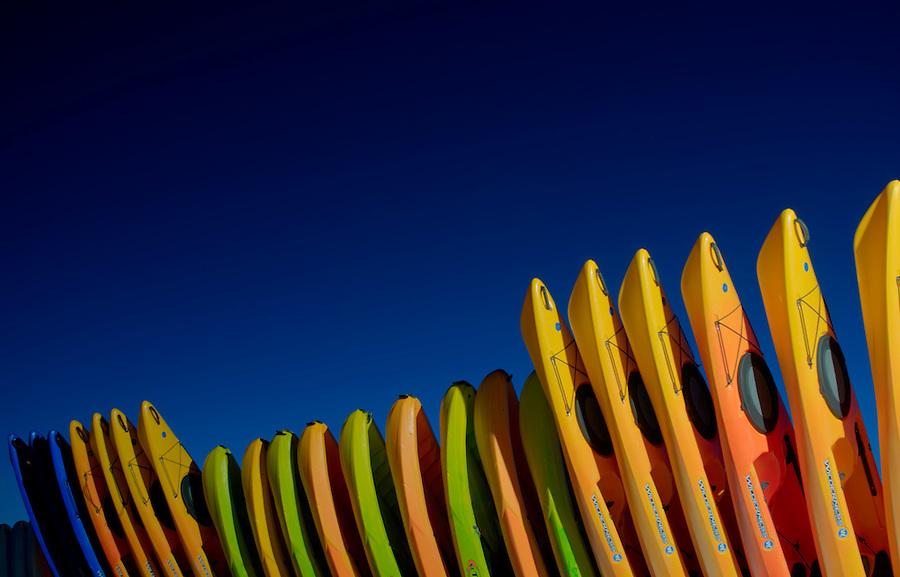 Colorful Kayaks lined up in Honeymoon Island, Florida.