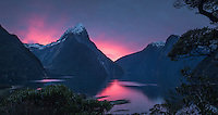 Intense sunset over Milford Sound and Mitre Peak, Fiordland National Park, Southland, UNESCO World Heritage Area, New Zealand, NZ