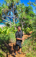 A Hawaiian man from O'ahu appreciates beauty along the Kalalau Trail near Hanakapi'ai Beach, Kaua'i.