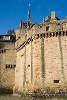 The Ramparts, 15th century military architecture, constructed mostly during the Hundred Years War, parapet resting on corbelled machicolations crowns both towers and walls, surrounding the Merveille (Marvel), 13th century, thanks to a donation by the king of France, Philip Augustus who offered Abbot Jourdain, a grant for the construction of a new Gothic-style architectural set, Le Mont Saint Michel, Manche, Basse Normandie, France. Picture by Manuel Cohen