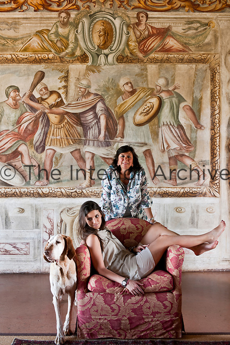 Owner Marianna Guerresco with her daughter Camilla and dog Ambra in front of one of the frescoes in their house