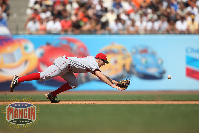SAN FRANCISCO - AUGUST 9:  Adam Rosales #23 of the Cincinnati Reds dives for a ball at third base against the San Francisco Giants during the game at AT&T Park on August 9, 2009 in San Francisco, California. Photo by Brad Mangin