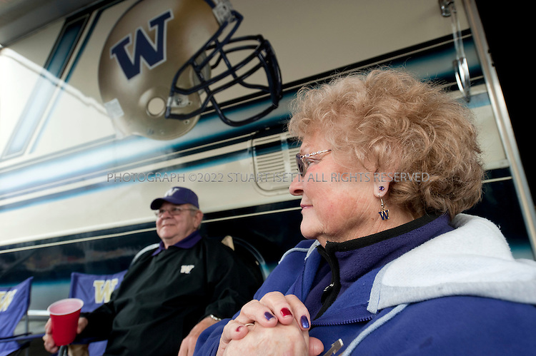 10/30-2010--Seattle, WA, USA..Jake (Jacob) Locker, 22, is the quarterback for the University of Washington Huskies football team. He is the starting quarterback at the on the teak and a top NFL draft prospect when he graduates in 2011. Originally from Ferndale, WASH., Scott Locker, Jake's father and friends and family from Ferndale have been regular tailgaters at all his games in a group called the 'Ferndawgs'...Here Jake's grandparents, Hugh and Barbara Locker, relax with other Ferndawg tailgaters in front of their RV before the game against Stanford, which the Huskies would lose 41-0 at home...©2010 Stuart Isett. All rights reserved.