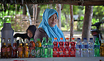 Rusmiati sells soft drinks at her stand on the tourist beach at Lhok Me, in Indonesia's Aceh province. The woman was left homeless by the 2004 tsunami, but YEU, a member of the ACT Alliance, worked with the village to build new houses in a safer area, as well as help revitalize their income generating activities. The tsunami killed 221,000 people in Aceh province and left more than 500,000 displaced.
