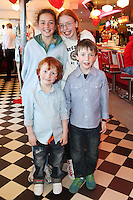 "NO REPRO FEE. 26/5/2011. NEW EDDIE ROCKET'S SHAKE SHOP. Rebecca, Ellen, Robert and Leo Fortune are pictured in the new Eddie Rocket's Shake Shop. The design seeks to recall the vintage milkshake bars from 1950's America and re-imagine them for the 21st century. The new look aims to appeal to both young and old with a quirky and bold colour scheme and a concept of make-your-own milkshakes, based on the tag line ""You make it...We shake it!"". Eddie Rocket's City Diner in the Stillorgan Shopping Centre in south Dublin has re-opened after an exciting re-vamp and the addition of a Shake Shop. Ten new jobs have been created with the Diner's re-launch bringing the total working in Eddie Rocket's Stillorgan to 30. Picture James Horan/Collins Photos"