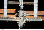 In Earth Orbit - July 6, 2006 -- The International Space Station approaches the Space Shuttle Discovery, from which this digital still image was recorded during rendezvous and docking activities on flight day three..Credit: NASA via CNP