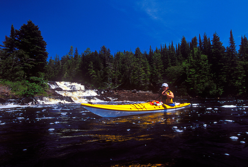 A sea kayaker paddles Lake Superior at the mouth of the Montreal River on the Keweenaw Peninsula near Lac LaBelle, Mich.
