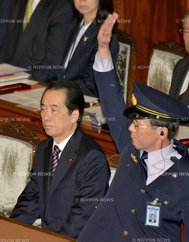 June 2nd, 2011, Tokyo, Japan - Standing next to Japans Prime Minister Naoto Kan, a security officer signals the end of casting of a non-confidence vote during a Diets lower house plenary session in Tokyo on Thursday, June 2, 2011. The non-confidence motion, submitted against Kan by the Liberal Democratic Party, New Komeito, and the Sunrise Party of Japan, was denied by 293 nays against 152 ayes in the 480-seat lower house. (Photo by Natsuki Sakai/AFLO) [3615] -mis-.