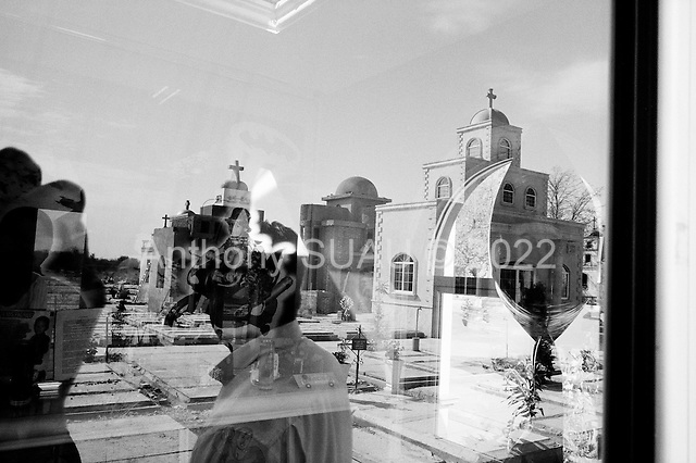 Culiacan, Mexico<br /> June 11, 2007<br /> <br /> The monuments to the dead in Culiacan. Many of the elaborate tombs are those of drug traffickers who were executed here. Certain tombs contain images of drug traffickers banishing their automatic weapons.