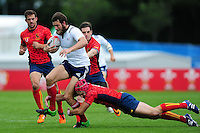 Nicolas Pouplot of France takes on the Spain defence. FISU World University Championship Rugby Sevens Men's 3rd/4th place Play-Off between Spain and France on July 9, 2016 at the Swansea University International Sports Village in Swansea, Wales. Photo by: Patrick Khachfe / Onside Images