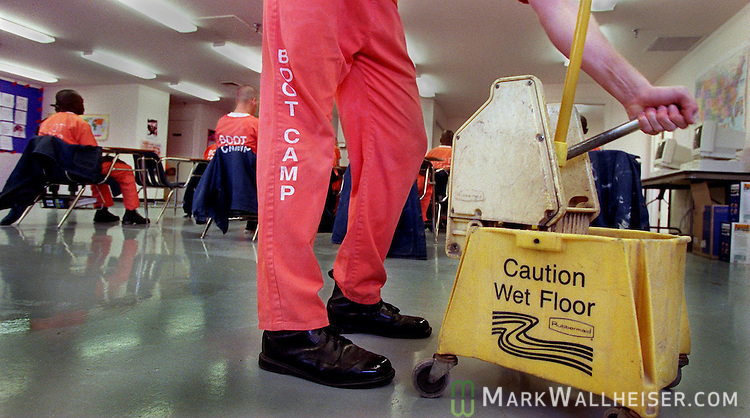 one of the juvenile offenders mops the floor at the