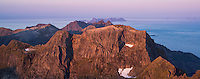 Morning light over mountain landscape from summit of Hermannsdalstinden, Moskenesoy, Lofoten Islands, Norway
