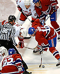 6 February 2007: Montreal Canadiens center and team captain Saku Koivu (11) of Finland wins a faceoff against the Carolina Hurricanes at the Bell Centre in Montreal, Canada. The Hurricanes went on to defeat the Canadiens 2-1.....Mandatory Photo Credit: Ed Wolfstein *** Editorial Sales through Icon Sports Media *** www.iconsportsmedia.com