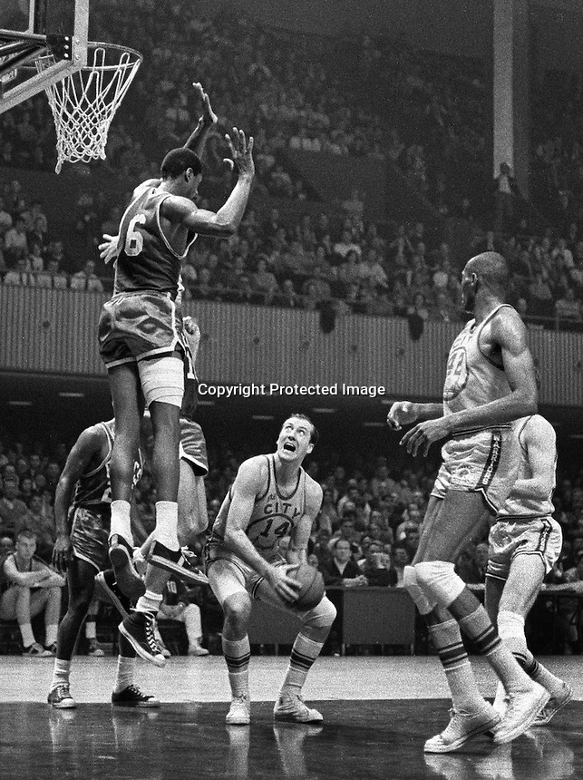 WARRIORS vs BOSTON celtics: 1967.Celtics Bill Russell leaping over Warriors Tom Mechery, Nate Thurmand on right. (photo by Ron Riesterer)